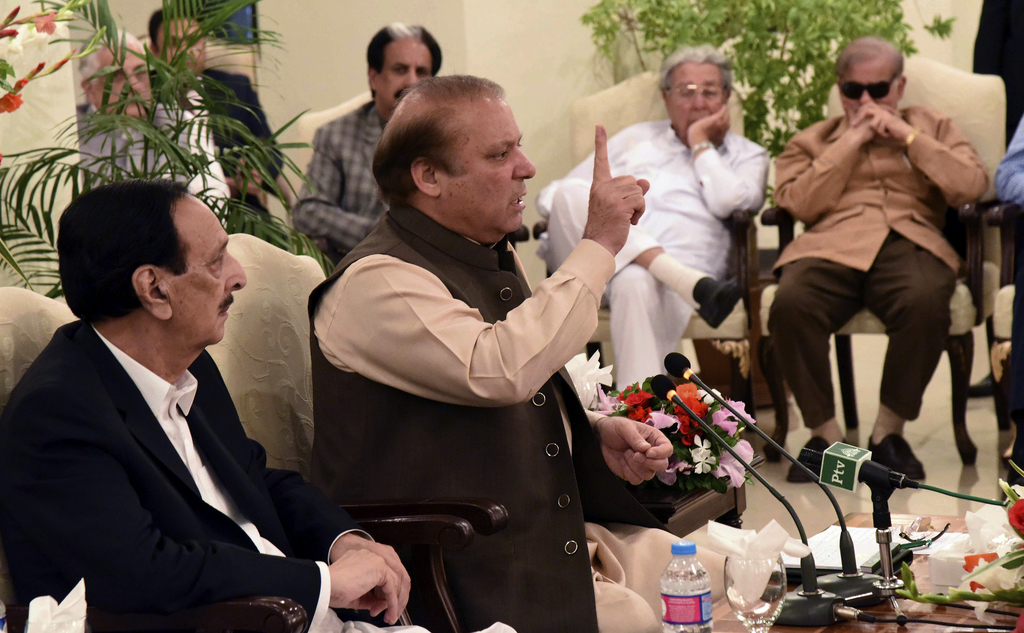 This photo released by Pakistan's Muslim League shows Pakistani ousted Prime Minister Nawaz Sharif addressing a party in Islamabad, Pakistan, Saturday...