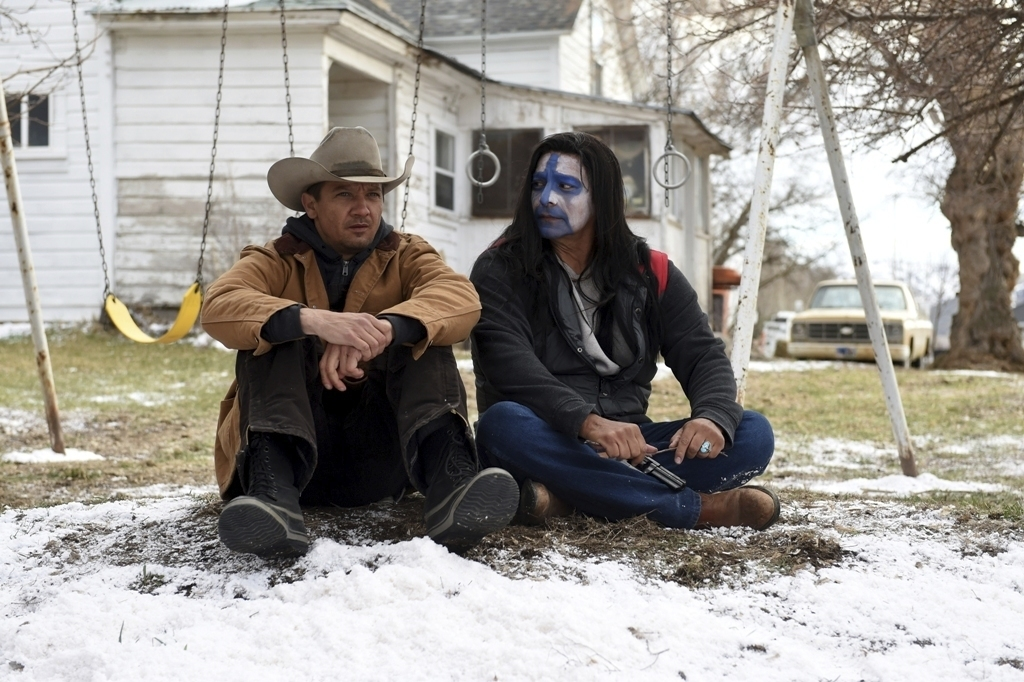 "This image released by The Weinstein Company shows Jeremy Renner, left, and Gil Birmingham in a scene from ""Wind River."" (Fred Hayes/The Weinstein Com..."