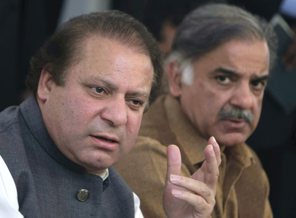 FILE - In this Feb. 17, 2008 file photo, Pakistan's deposed Prime Minister Nawaz Sharif, left, addresses a news conference with his brother Shahbaz Sh...