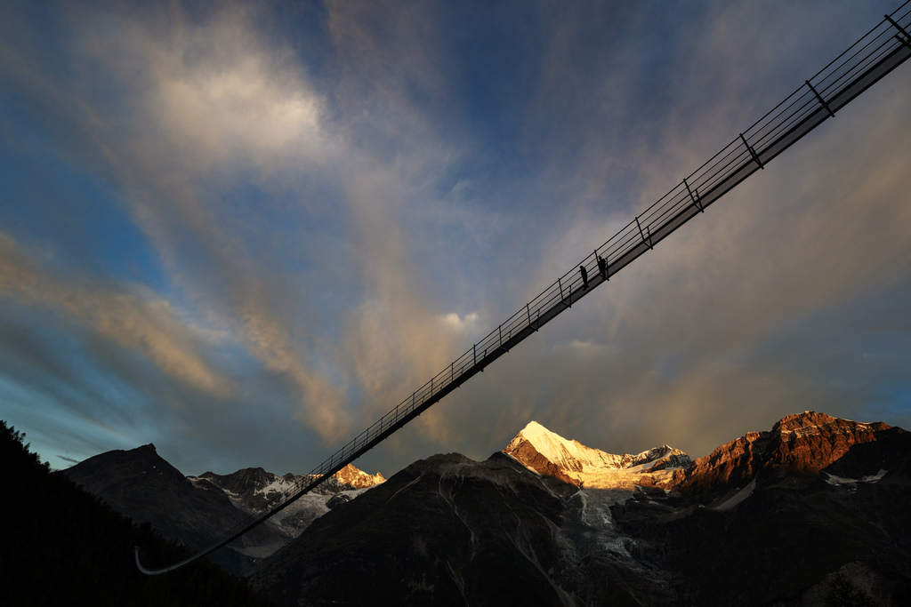 """A couple walks on the """"Europabruecke"""",  supposed to be the world's longest pedestrian suspension bridge with a length of 494m, prior to the official i..."""