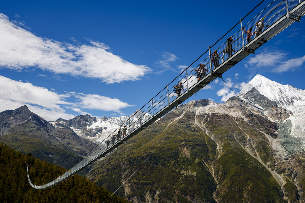 """People walk on the """"Europabruecke"""",  that is supposed to be the world's longest pedestrian suspension bridge with a length of 494m, after the official..."""