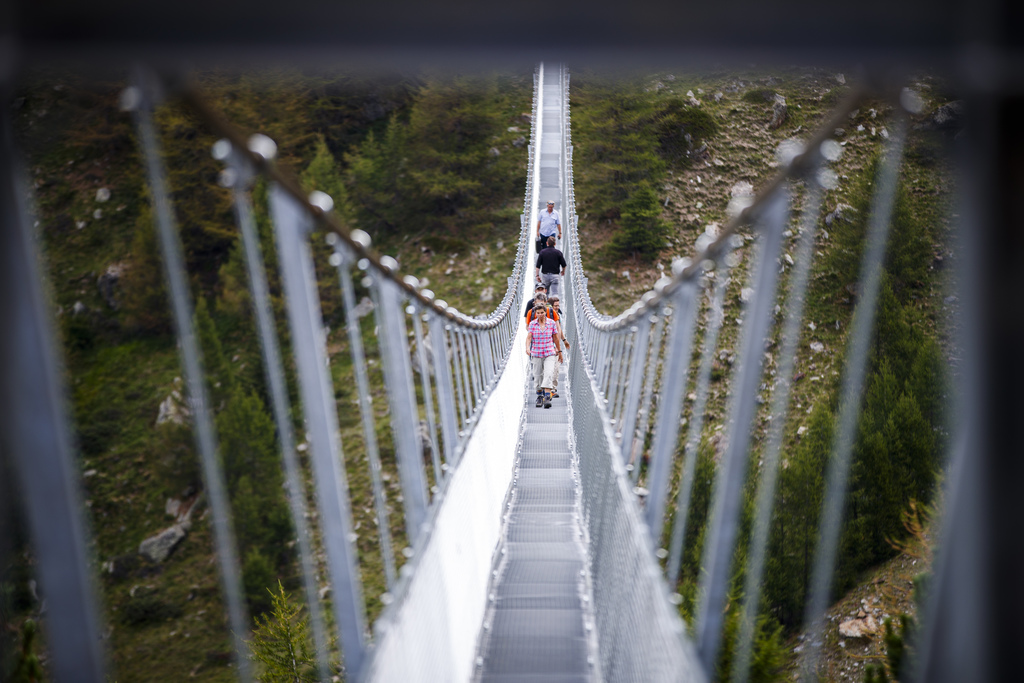 """People walk on the """"Europabruecke"""",  supposed to be the world's longest pedestrian suspension bridge with a length of 494m, after the official inaugur..."""
