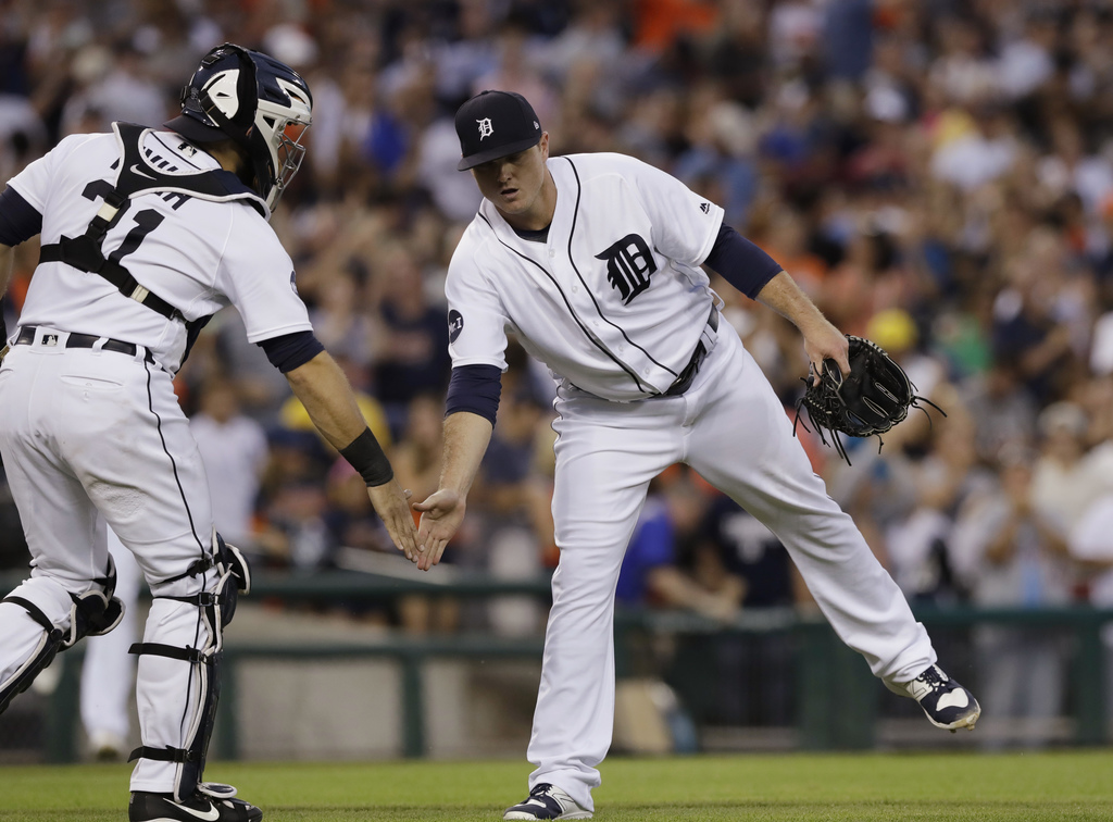 Detroit Tigers relief pitcher Justin Wilson greets catcher Alex Avila after the team's 5-3 win over the Houston Astros in a baseball game, Saturday, J...