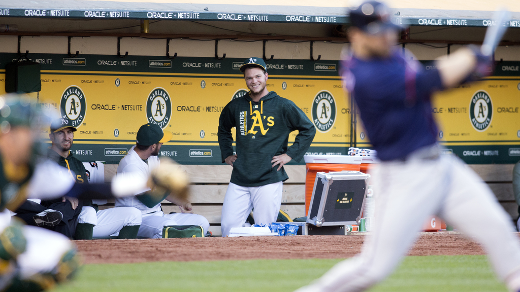 Oakland Athletics' Sonny Gray, center, watches from the dugout as his team takes on the Minnesota Twins during the fourth inning of a baseball game on...
