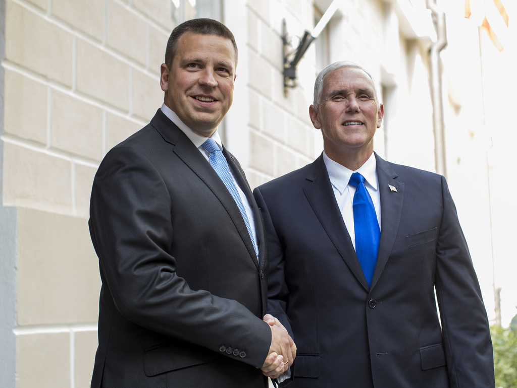 U.S. Vice President Mike Pence, right, and Estonia's Prime Minister Juri Ratas pose for photographers prior to their meeting at the Government palace ...