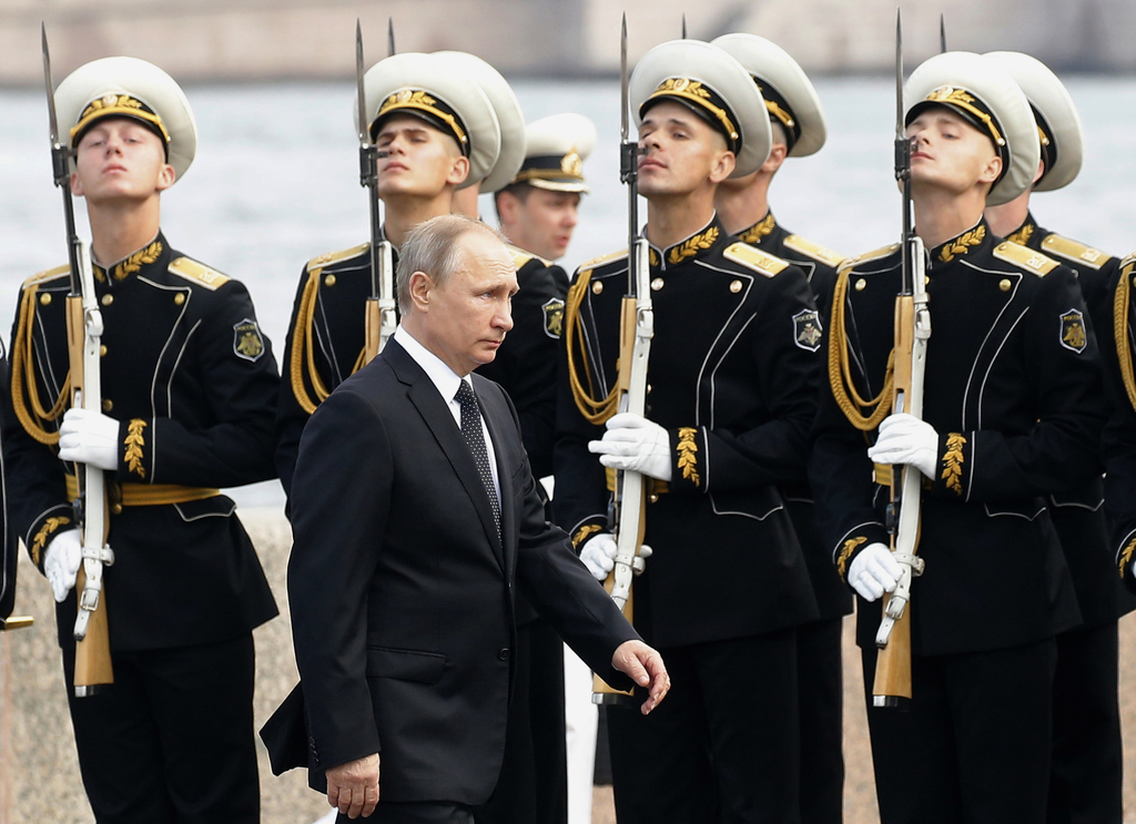 Russian President Vladimir Putin arrives to attend the military parade during the Navy Day celebration in St. Petersburg, Russia, on Sunday, July 30, ...