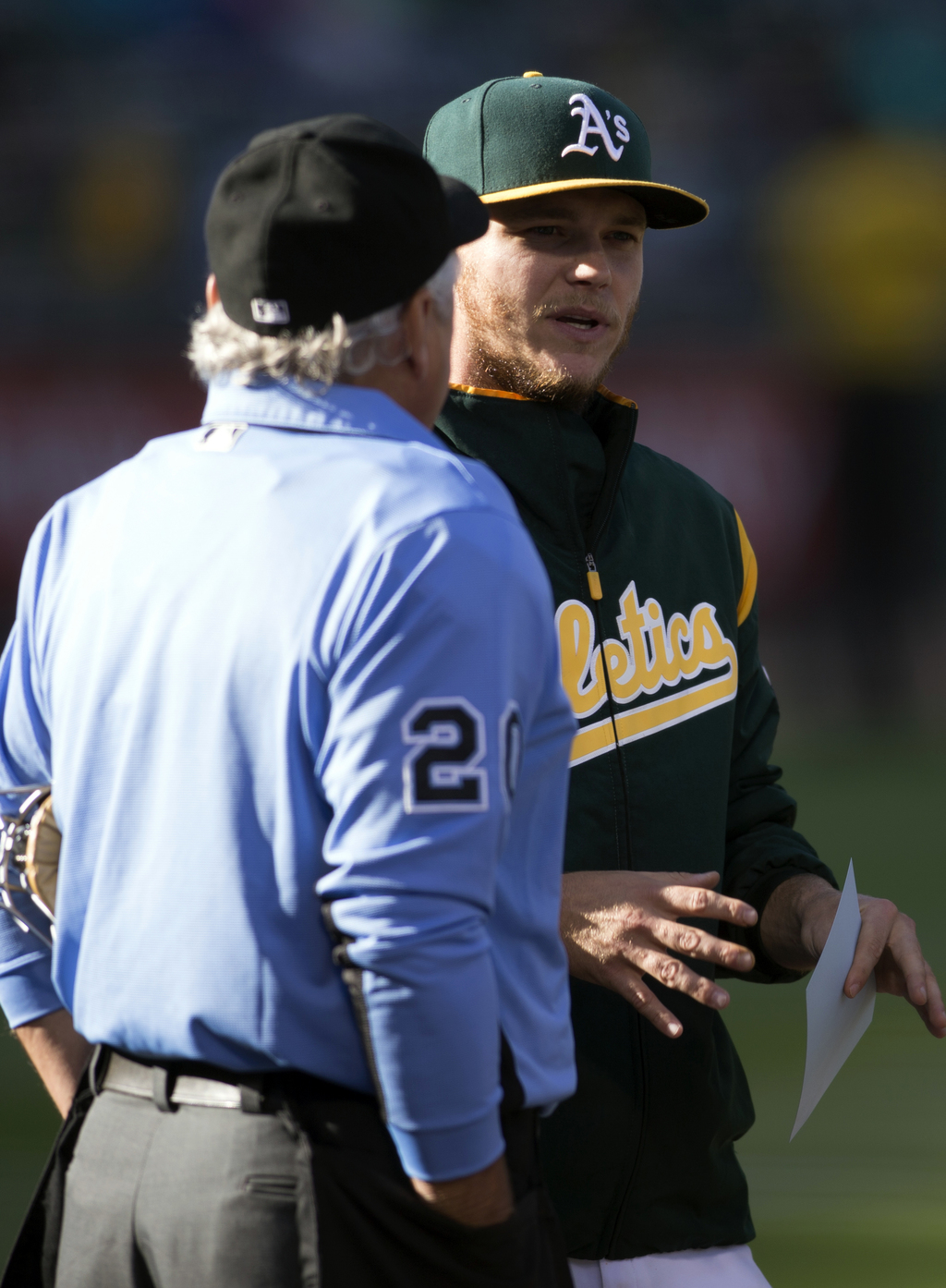 Oakland Athletics' Sonny Gray, right, talks with home plate umpire Tom Hellion before  a baseball game against the Minnesota Twins, Saturday, July 29,...
