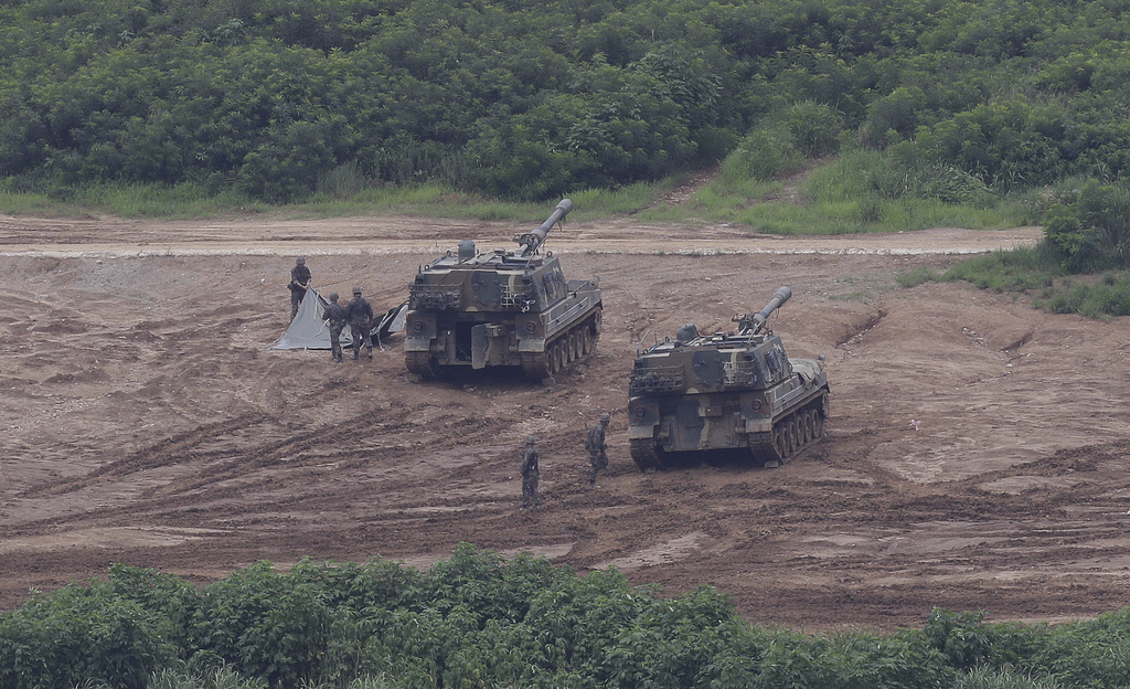 South Korean army soldiers prepare their military exercise in Paju, South Korea, near the border with North Korea, Sunday, July 30, 2017. The United S...