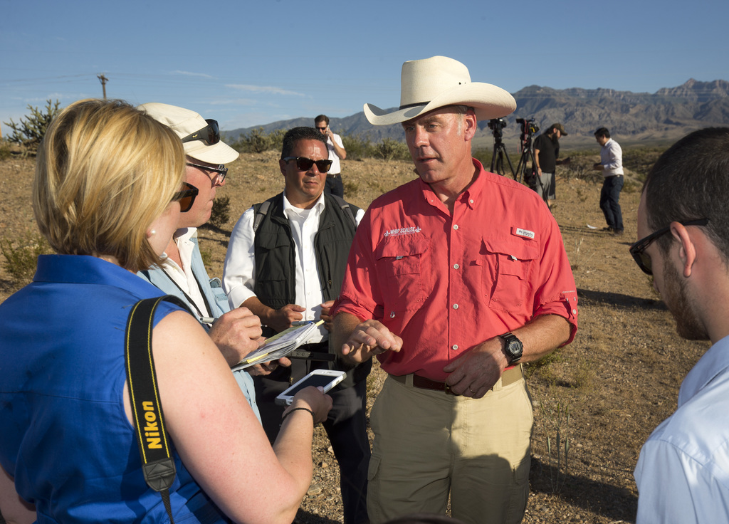U.S. Interior Secretary Ryan Zinke speaks with members of the media during a news conference near Gold Butte National Monument in Bunkerville, Nev., S...