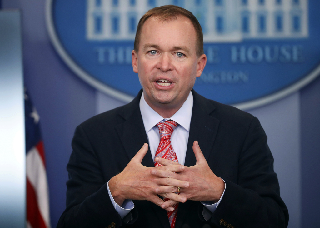 FILE - In this Thursday, July 20, 2017, file photo, Budget Director Mick Mulvaney gestures as he speaks during the daily press briefing at the White H...