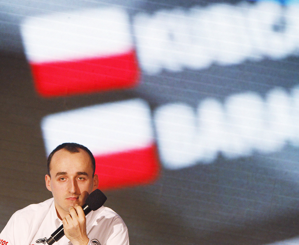 FILE - This is a Thursday, March 14, 2013 file photo of former Formula One driver Robert Kubica at a news conference in Warsaw, Poland. Kubica, who la...