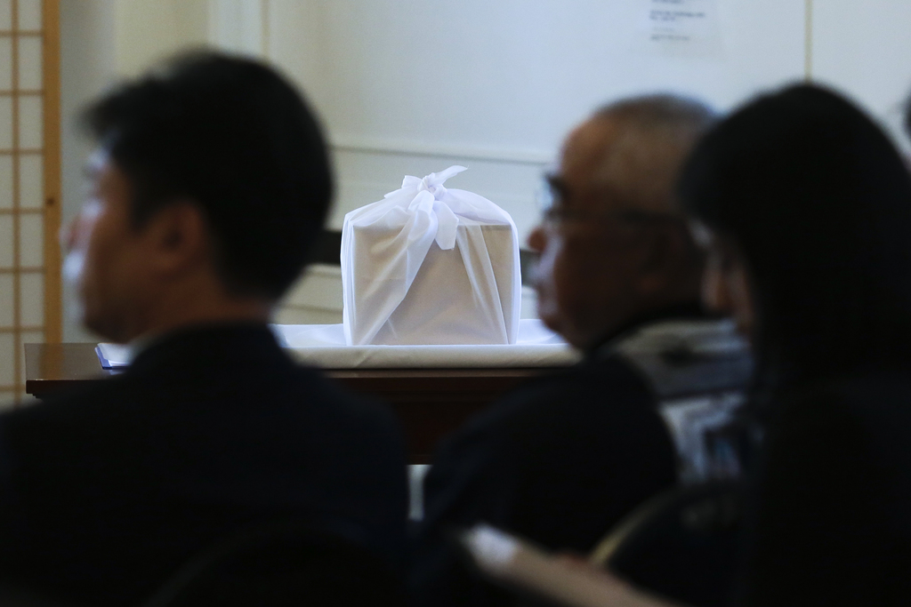 A box containing a skull of Japan's Ainu people is on display  during a ceremony at the Japanese embassy in Berlin, Monday, July 31, 2017. The skull w...
