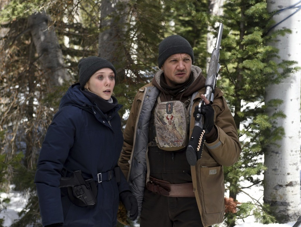 "This image released by The Weinstein Company shows Elizabeth Olsen, left, and Jeremy Renner in a scene from ""Wind River."" (Fred Hayes/The Weinstein Co..."