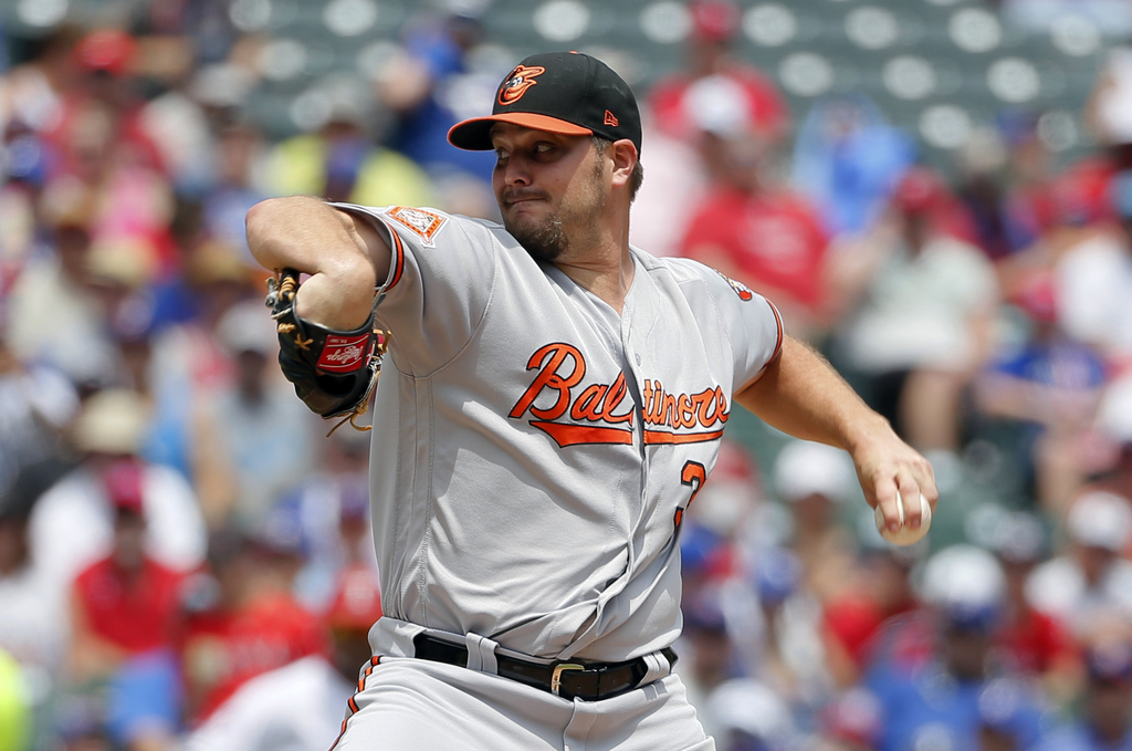 Baltimore Orioles starting pitcher Wade Miley throws to the Texas Rangers in the first inning of a baseball game, Sunday, July 30, 2017, in Arlington,...