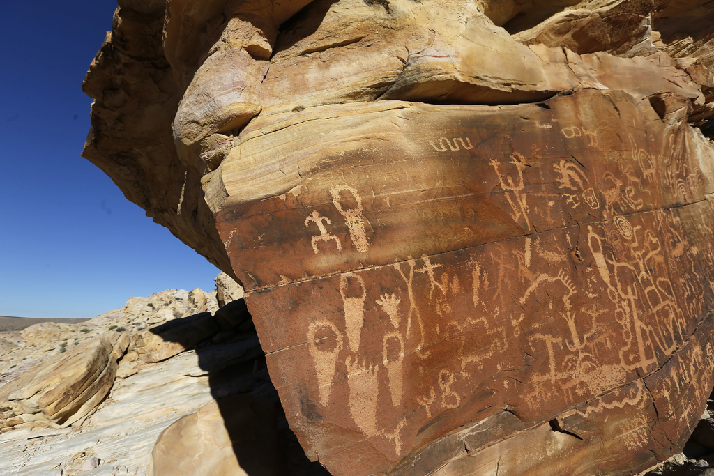 FILE - This Jan. 17, 2017 file photo shows petroglyphs at Gold Butte National Monument in Gold Butte, Nev.  U.S. Interior Secretary Ryan Zinke is maki...