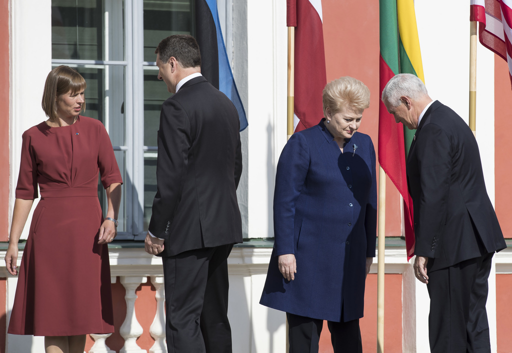 U.S. Vice President Mike Pence, right, and Lithuania's President Dalia Grybauskaite, second from right, bow each other as Estonia's President Kersti K...