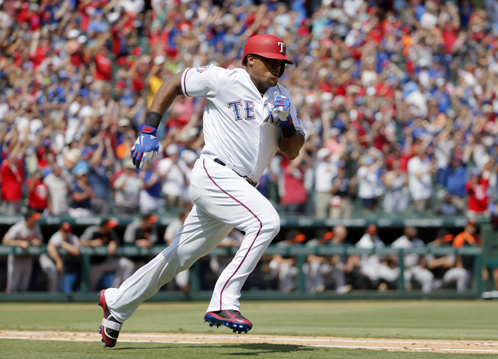Texas Rangers' Adrian Beltre sprints around first to second after hitting for a double off a pitch from Baltimore Orioles' Wade Miley in the fourth in...
