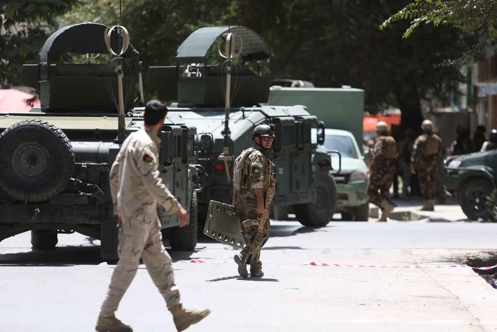 Afghan security forces arrive at the site of complex attack in Kabul, Afghanistan, Monday, July 31, 2017. Afghan police say a car bombing has targeted...