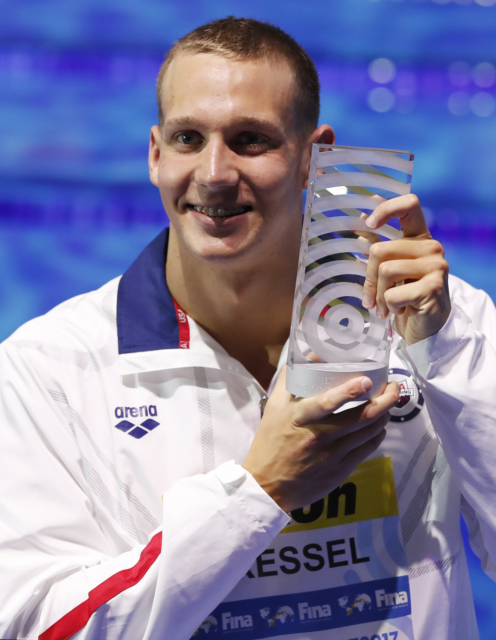 United States' Caeleb Remel Dressel who won 7 gold medals shows off the award as best male athlete during the swimming competitions of the World Aquat...