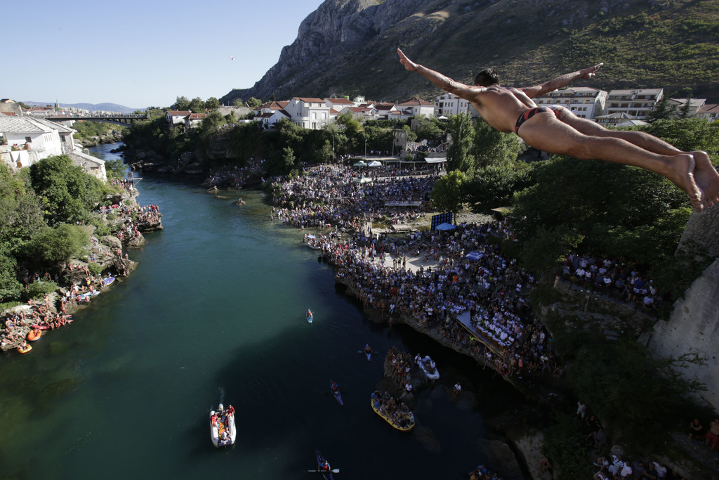 A diver drops through the air from the Mostar bridge during traditional jump during 451th traditional annual high diving competition, in Mostar, 140 k...
