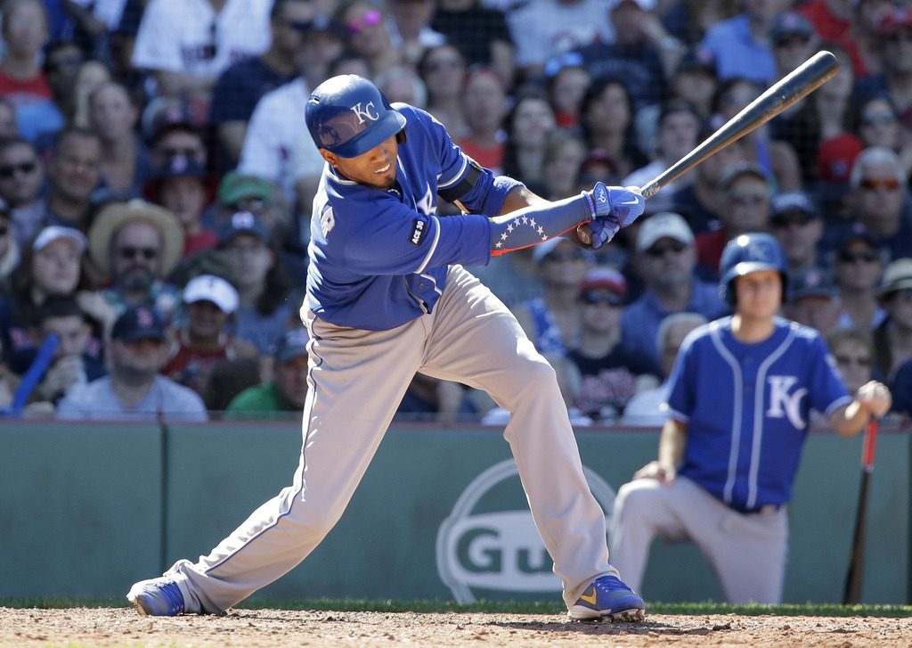 Kansas City Royals' Alcides Escobar hits a two-run single in the eighth inning of a baseball game against the Boston Red Sox, Sunday, July 30, 2017, i...