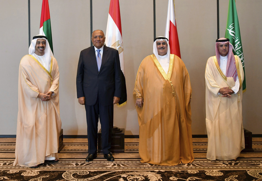 In this Sunday, July 30, 2017 photo released by Bahrain News Agency, from left to right, Foreign Ministers of UAE Abdullah bin Zayed al-Nahyan, Egypt'...