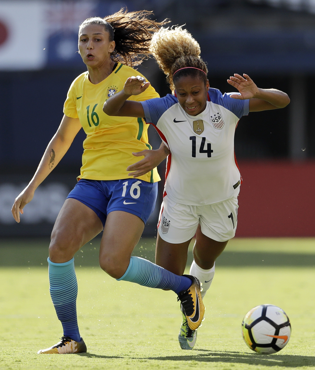 Brazil forward Bia Zaneratto (16) fouls United States defender Casey Short (14) during the first half of a Tournament of Nations women's soccer match ...