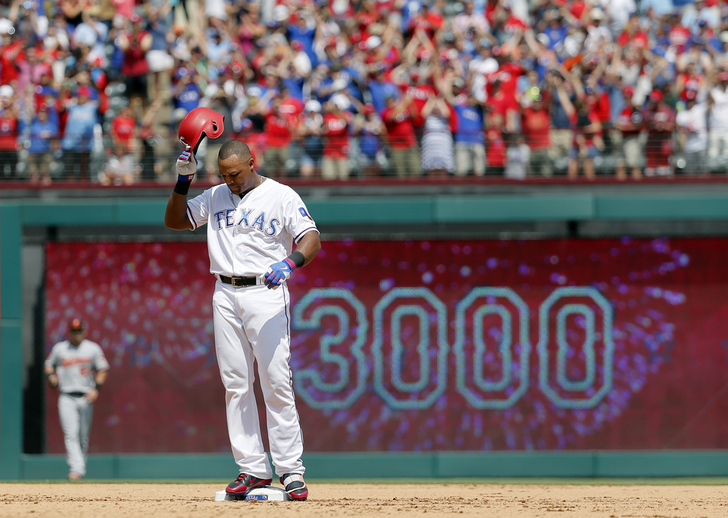 Texas Rangers' Adrian Beltre tips his helmet as he acknowledges cheers after hitting a double for his 3,000th career hit that came off a pitch from Ba...