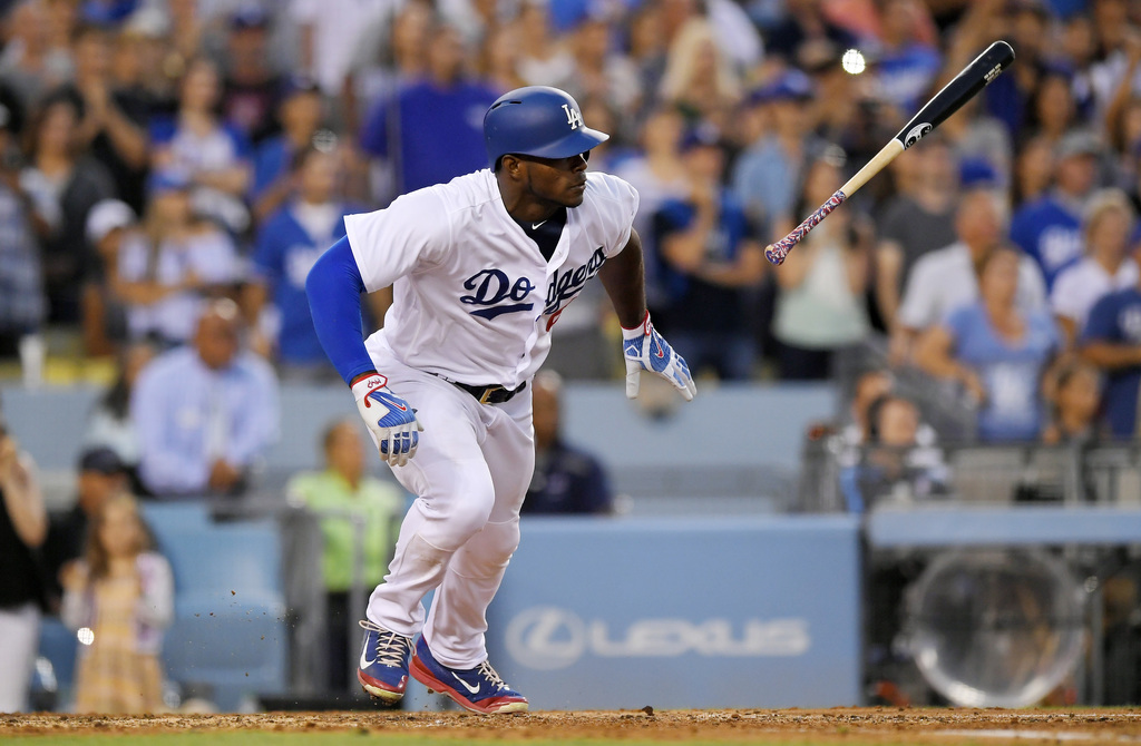 Los Angeles Dodgers' Yasiel Puig hits an RBI single during the ninth inning of a baseball game against the San Francisco Giants, Sunday, July 30, 2017...