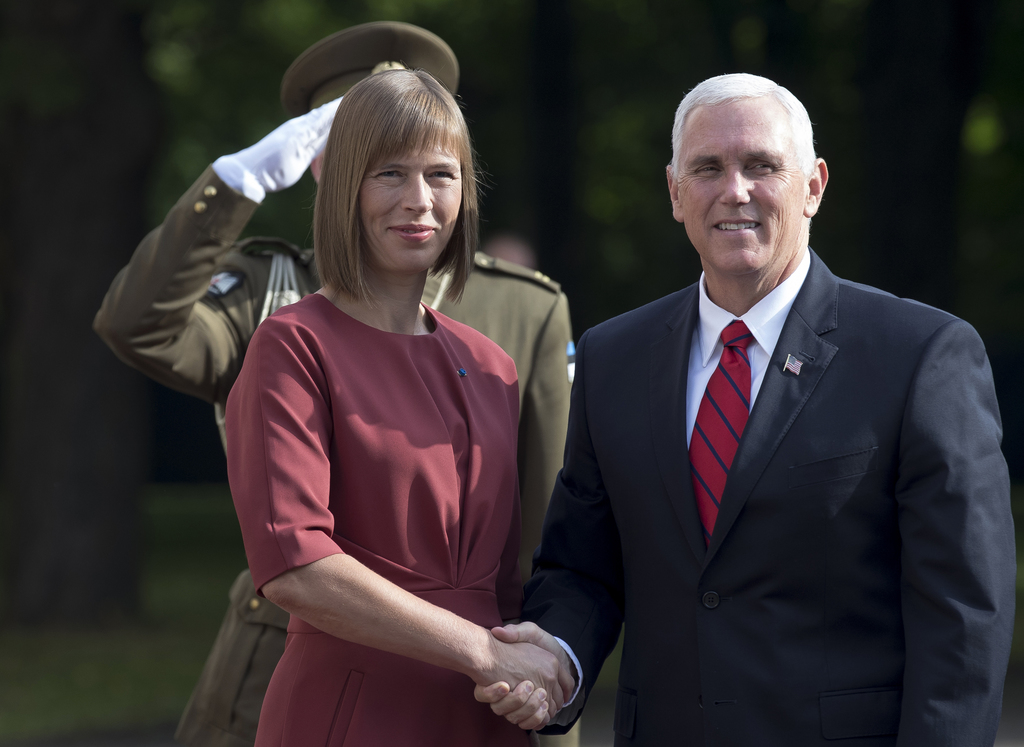 U.S. Vice President Mike Pence, right, and Estonia's President Kersti Kaljulaid pose for photographers prior to their meeting at the Kadriorg Palace i...