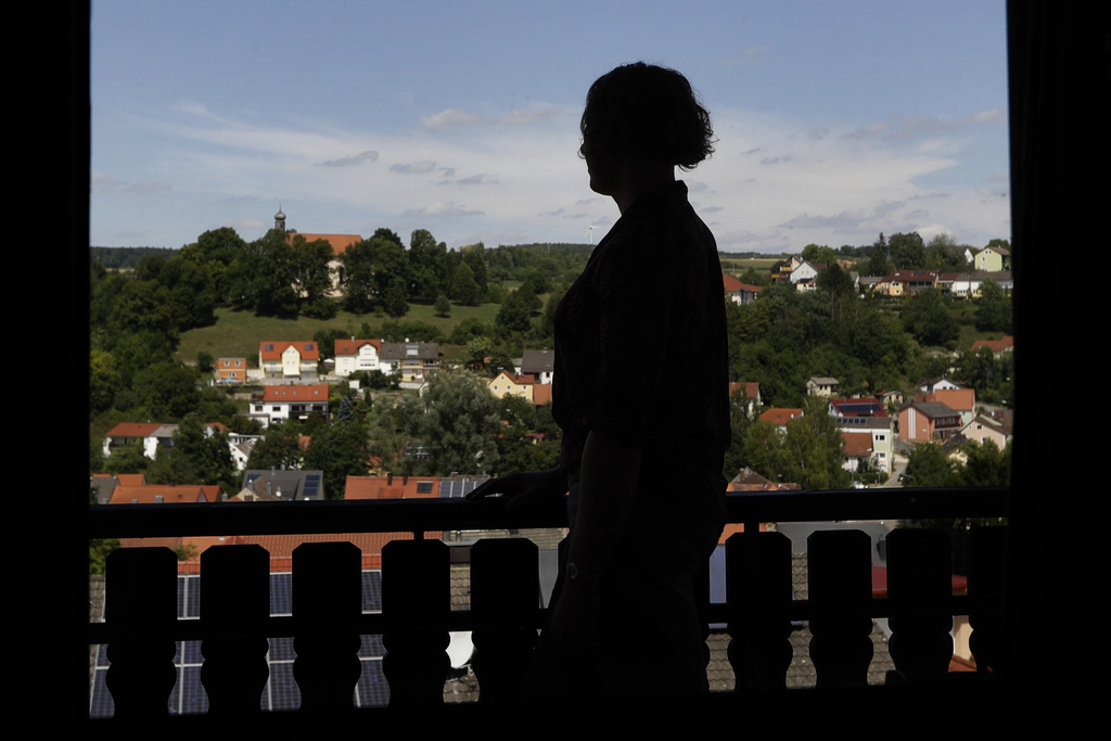In this July 29, 2017 photo transgender U.S. army captain  Jennifer Sims is silhouetted on a balcony after an interview with The Associated Press in B...