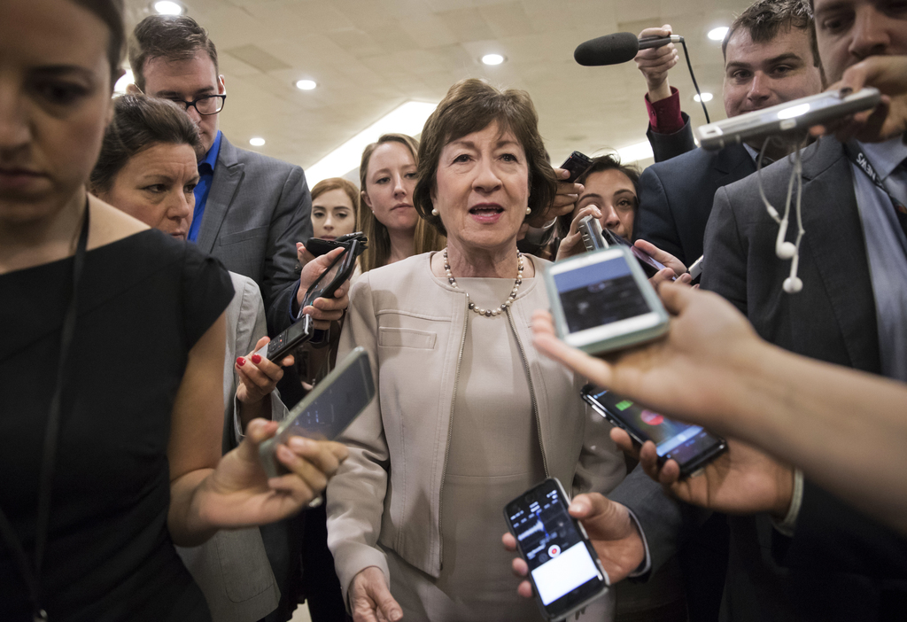 FILE - In this Tuesday, July 25, 2017, photo, Sen. Susan Collins, R-Maine is surrounded by reporters as she arrives on Capitol Hill in Washington, bef...