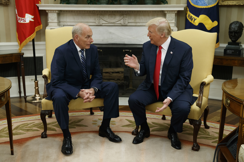 President Donald Trump talks with new White House Chief of Staff John Kelly after he was privately sworn in during a ceremony in the Oval Office with ...