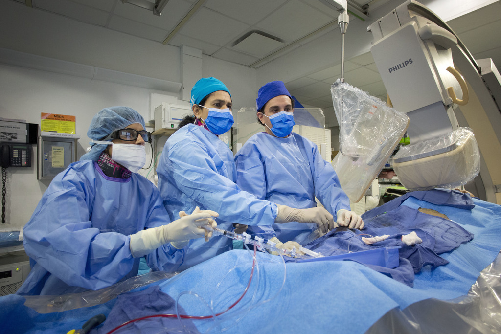 In this Feb. 16, 2017 photo, Dr. Annapoorna Kini, center, performs a non-emergency angioplasty at Mount Sinai Hospital in New York. Through a blood ve...