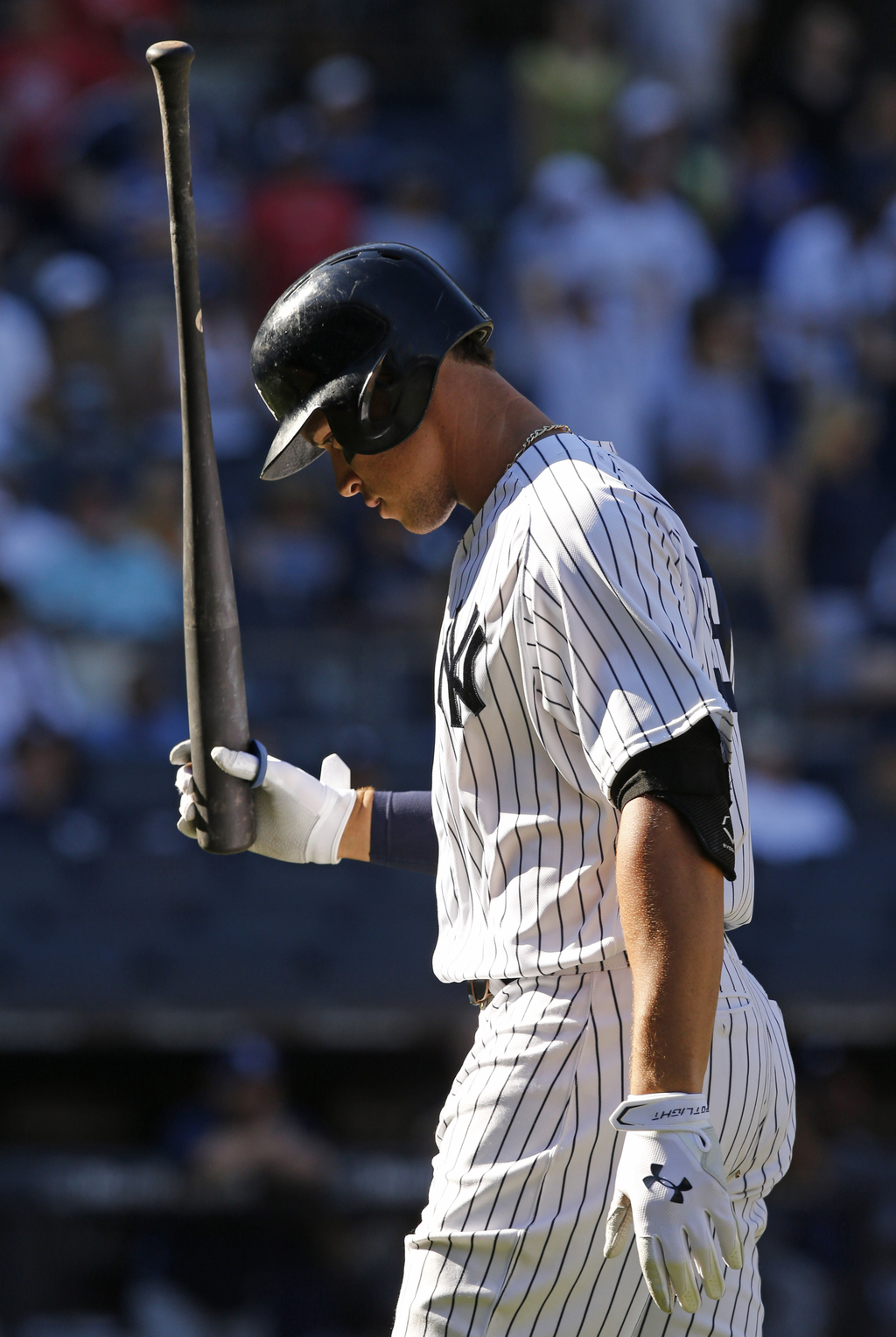 New York Yankees' Aaron Judge reacts after fouling out to first with two runners on base in the ninth inning of a baseball game against the Tampa Bay ...
