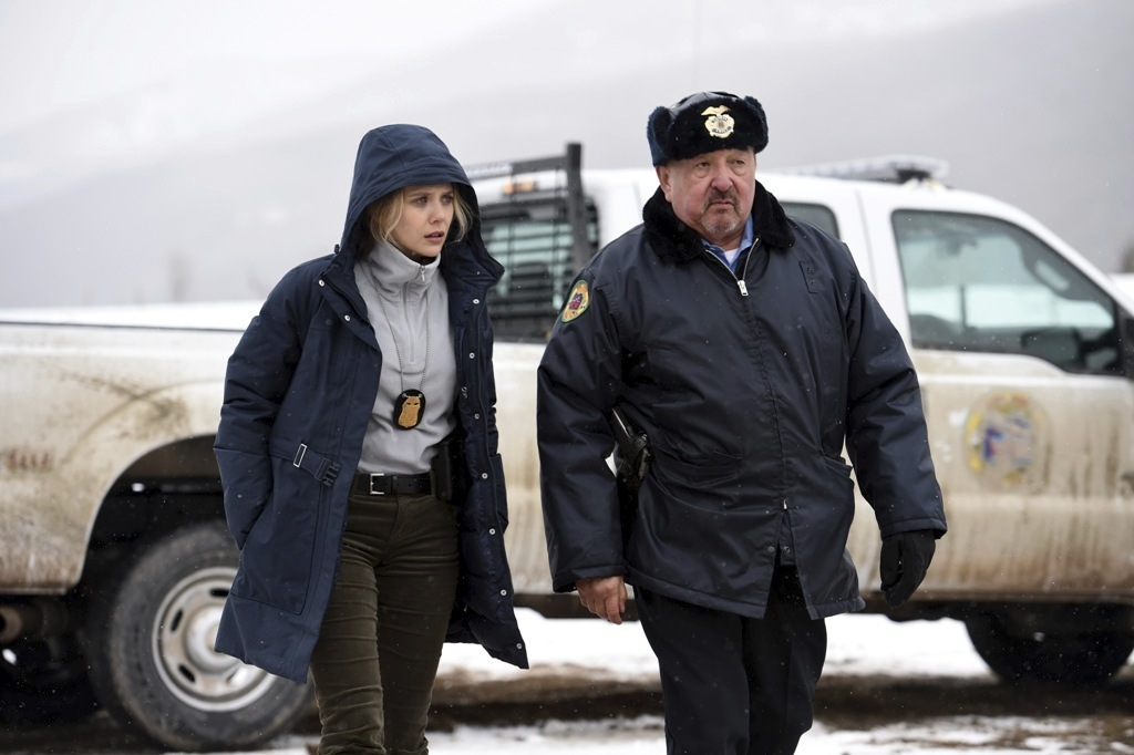 "This image released by The Weinstein Company shows Elizabeth Olsen, left, and Graham Greene in a scene from ""Wind River."" (Fred Hayes/The Weinstein Co..."