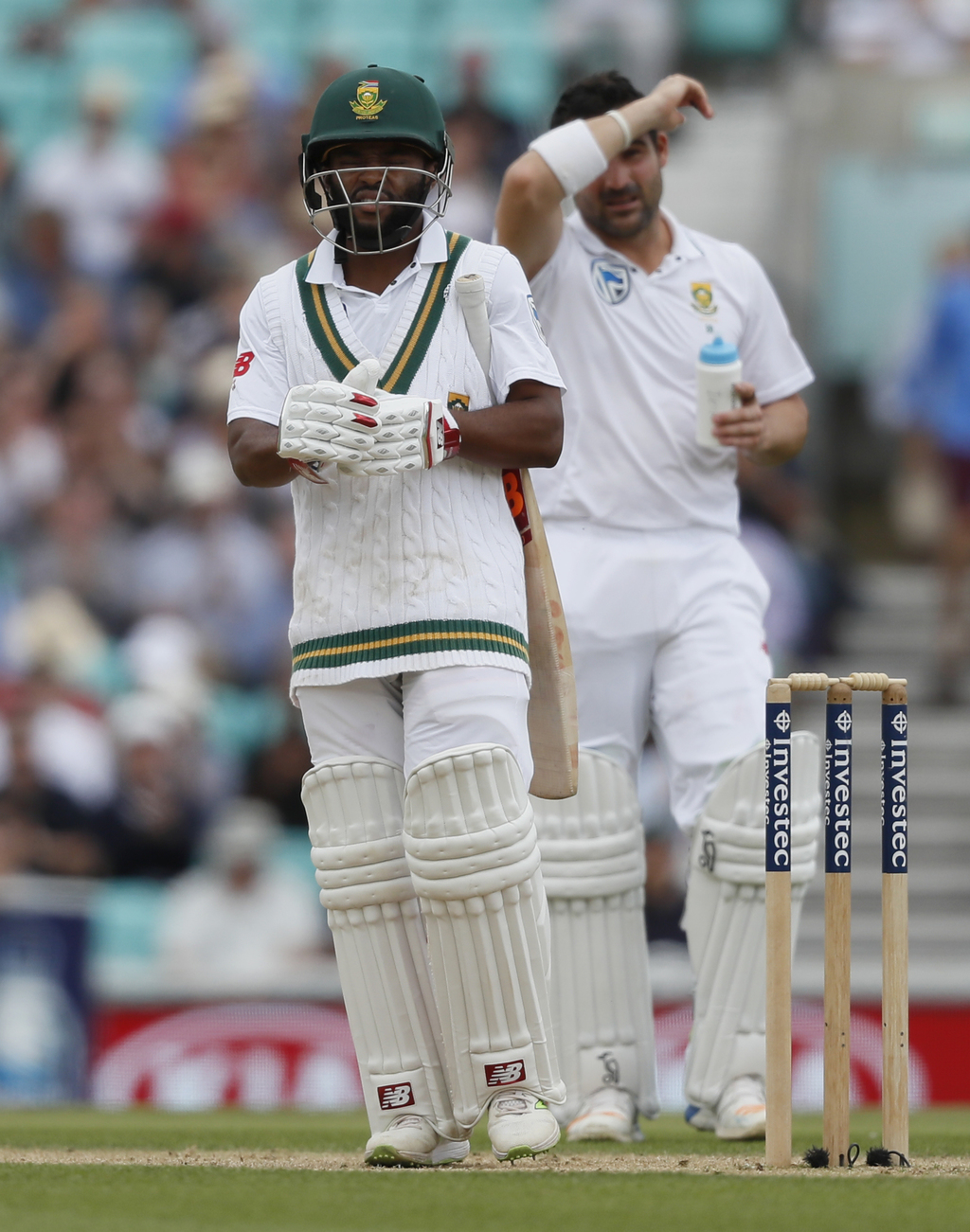 South Africa's Temba Bavuma leaves the pitch after being bowled lbw by England's Toby Roland-Jones on the fifth day of the third test match between En...