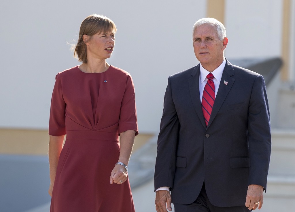U.S. Vice President Mike Pence, right, and Estonia's President Kersti Kaljulaid walk together prior to their meeting at the Kadriorg Palace in Tallinn...