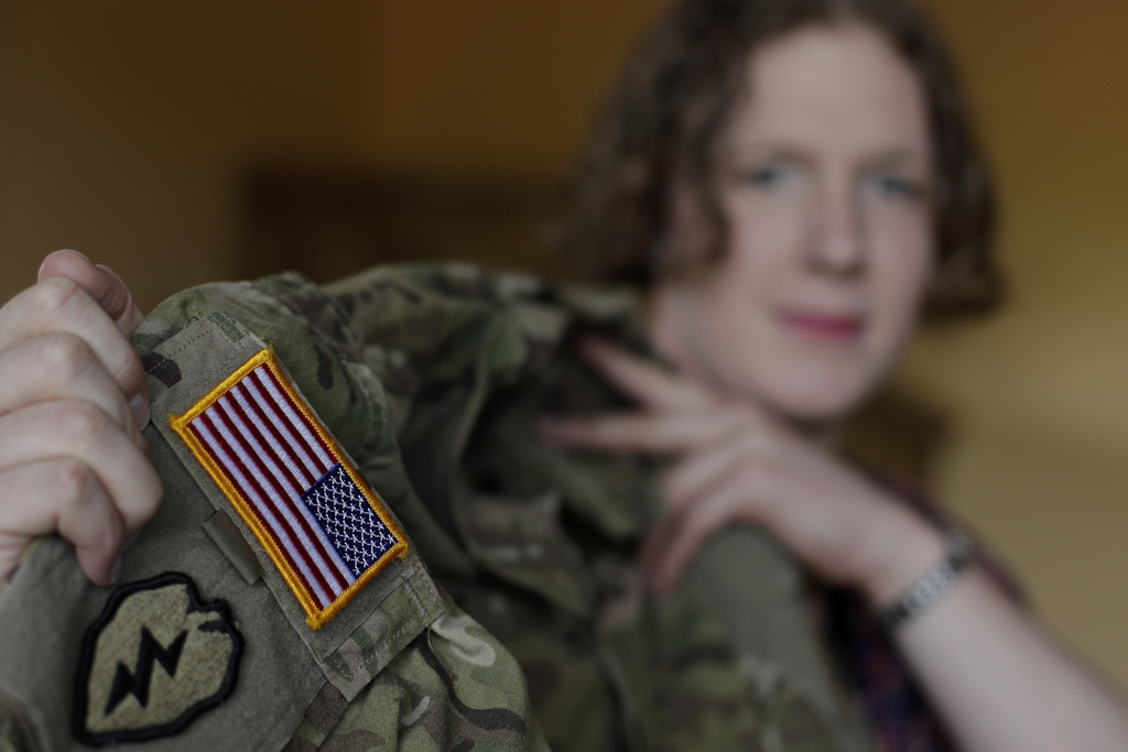 In this July 29, 2017 photo transgender U.S. army captain  Jennifer Sims lifts her uniform during an interview with The Associated Press in Beratzhaus...