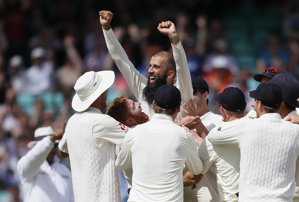 England's Moeen Ali is lifted by his team mates after he scores a hat trick to get the wicket of South Africa's Morne Morkel to win the test match on ...