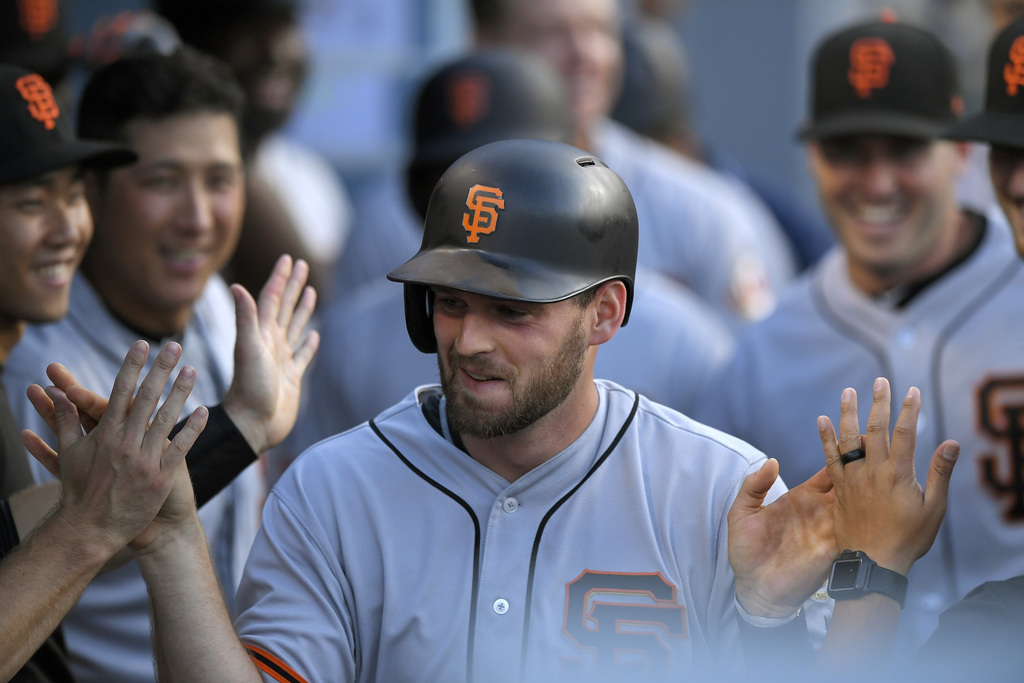 San Francisco Giants' Conor Gillaspie is congratulated by teammates after hitting a solo home run during the eighth inning of a baseball game Los Ange...