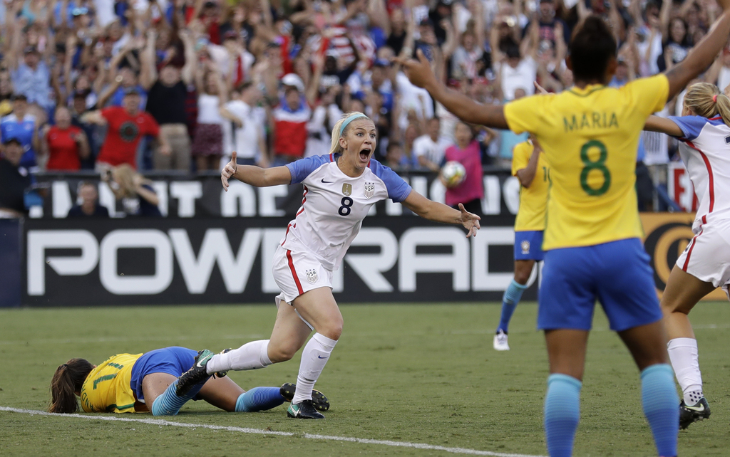United States defender Julie Ertz, center, reacts after scoring the go-ahead goal against Brazil during the second half of a Tournament of Nations wom...