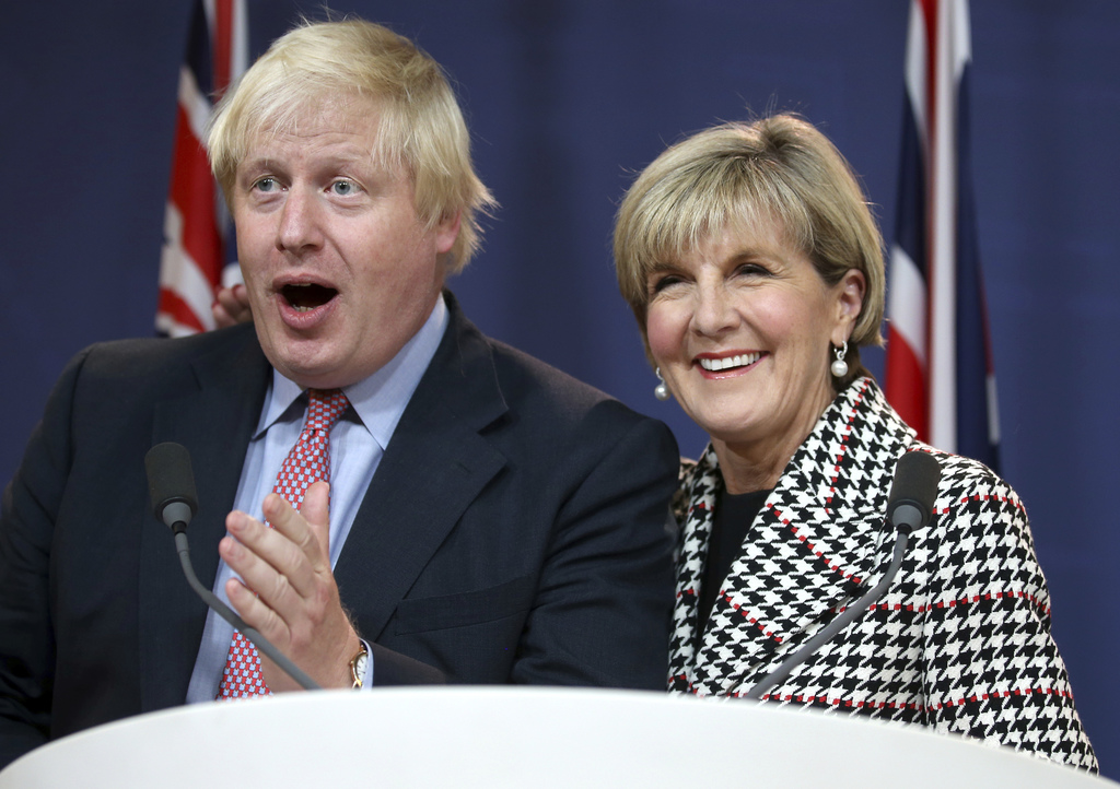 FILE - In this July 27, 2017 file photo, Australian Foreign Minister Julie Bishop, right, puts her arm around British Foreign Secretary Boris Johnson ...