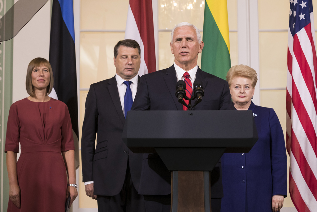 U.S. Vice President Mike Pence, second from right, accompanied by the leaders of Baltic states, from left, Estonian President Kersti Kaljulaid, Latvia...