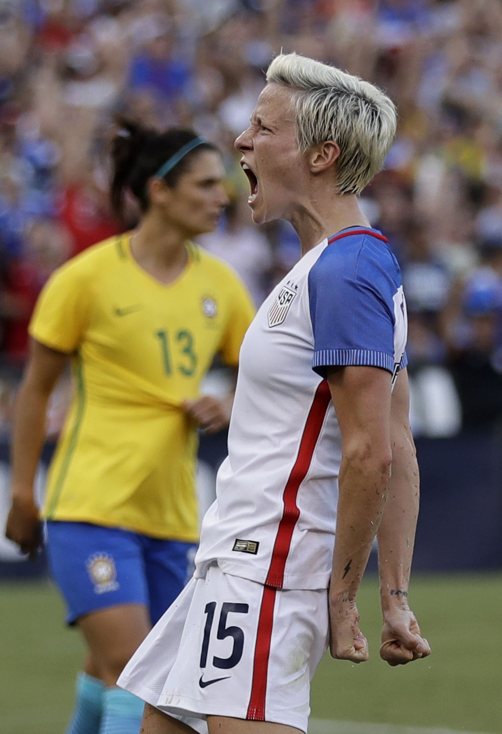 United States midfielder Megan Rapinoe, right, reacts after scoring a goal against Brazil during the second half of a Tournament of Nations women's so...