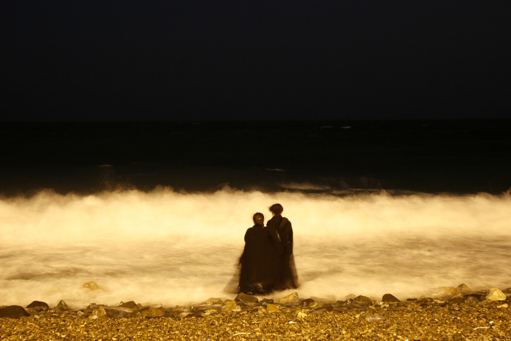 FILE - In this Tuesday, Dec. 26, 2007 file photo, two veiled Saudi women enjoy the Red Sea at night, in Jiddah, Saudi Arabia. Saudi Arabia is planning...