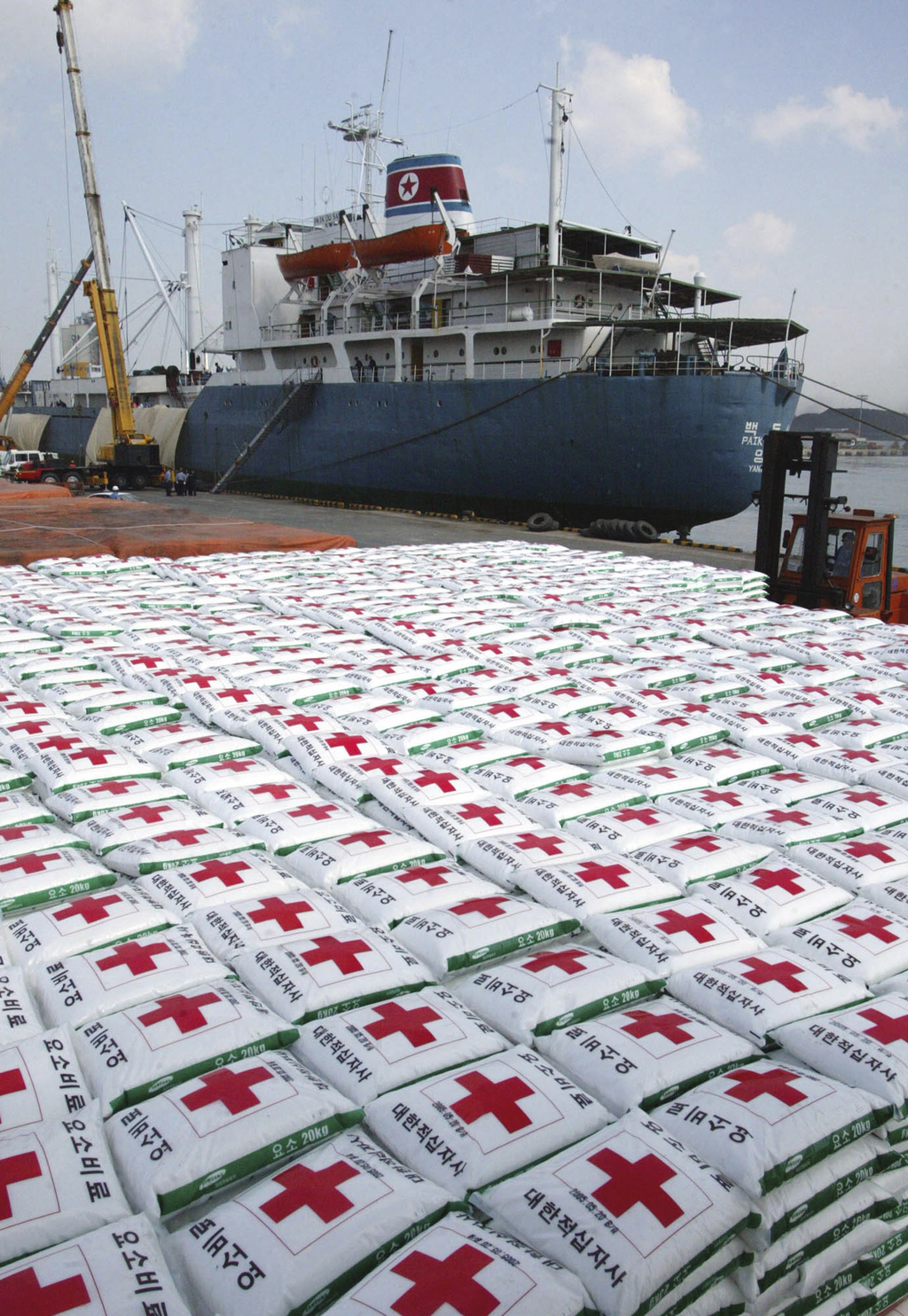FILE, In this May 23, 2005 file photo, a North Korea cargo ship Paik Du San cast anchor as the bags of fertilizer are loading its at Ulsan port in Uls...