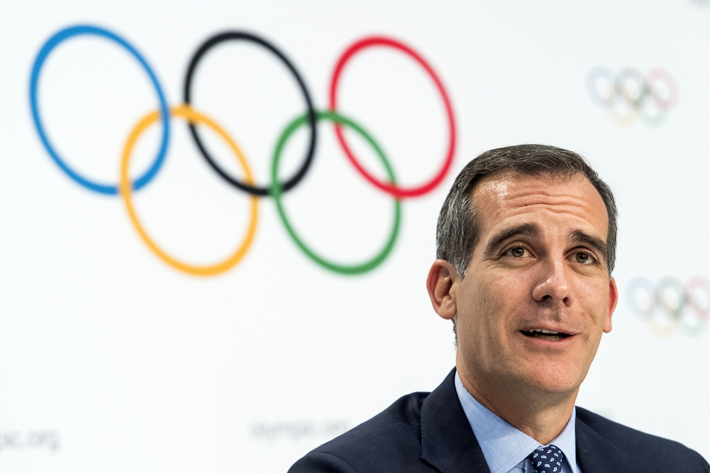FILE - In this July 11, 2017 file photo Mayor of Los Angeles Eric Garcetti speaks, during a press conference after the International Olympic Committee...