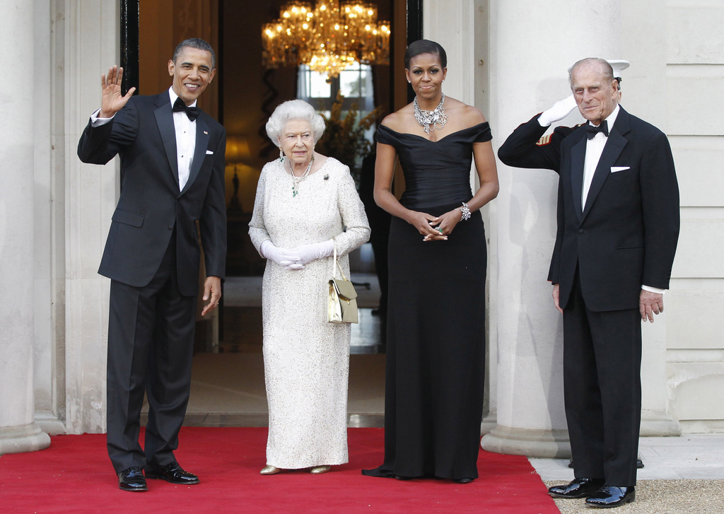 FILE - In this Wednesday, May 25, 2011 file photo President Barack Obama and first lady Michelle Obama welcome Britain's Queen Elizabeth II and Prince...