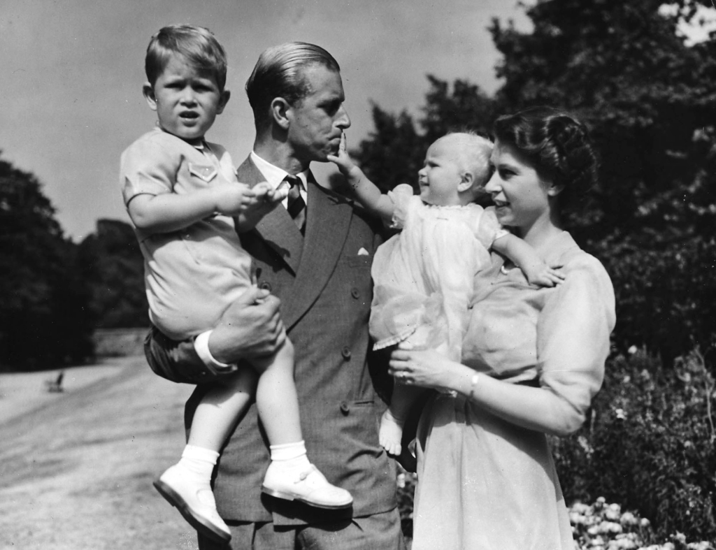 FILE - In this Aug. 1951 file photo then Princess Elizabeth stands with her husband Prince Philip, the Duke of Edinburgh, and their children Prince Ch...